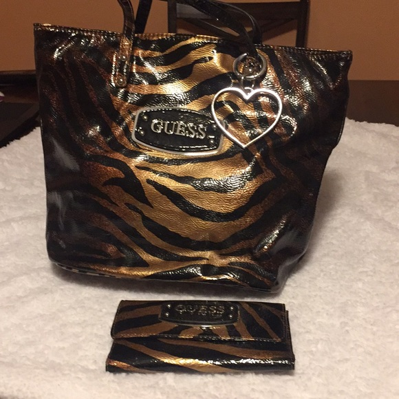 Guess Handbags - Guess purse with wallet barely used no tears